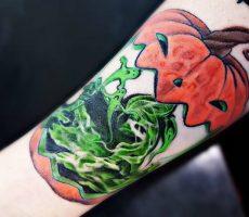 neotraditional pumpkin guts halloween tattoo