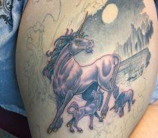 neotraditional unicorn tattoo