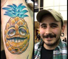 neotraditional color pineapple portrait tattoo